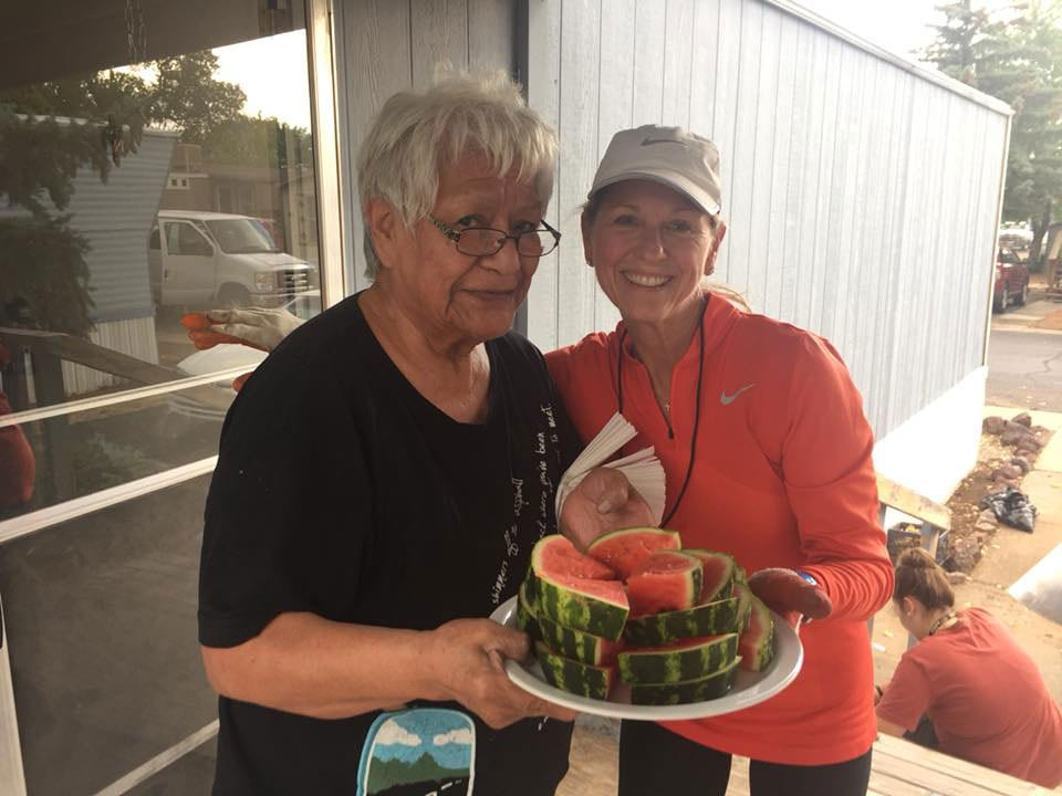 Ms Melinda Homeowner serving watermelon